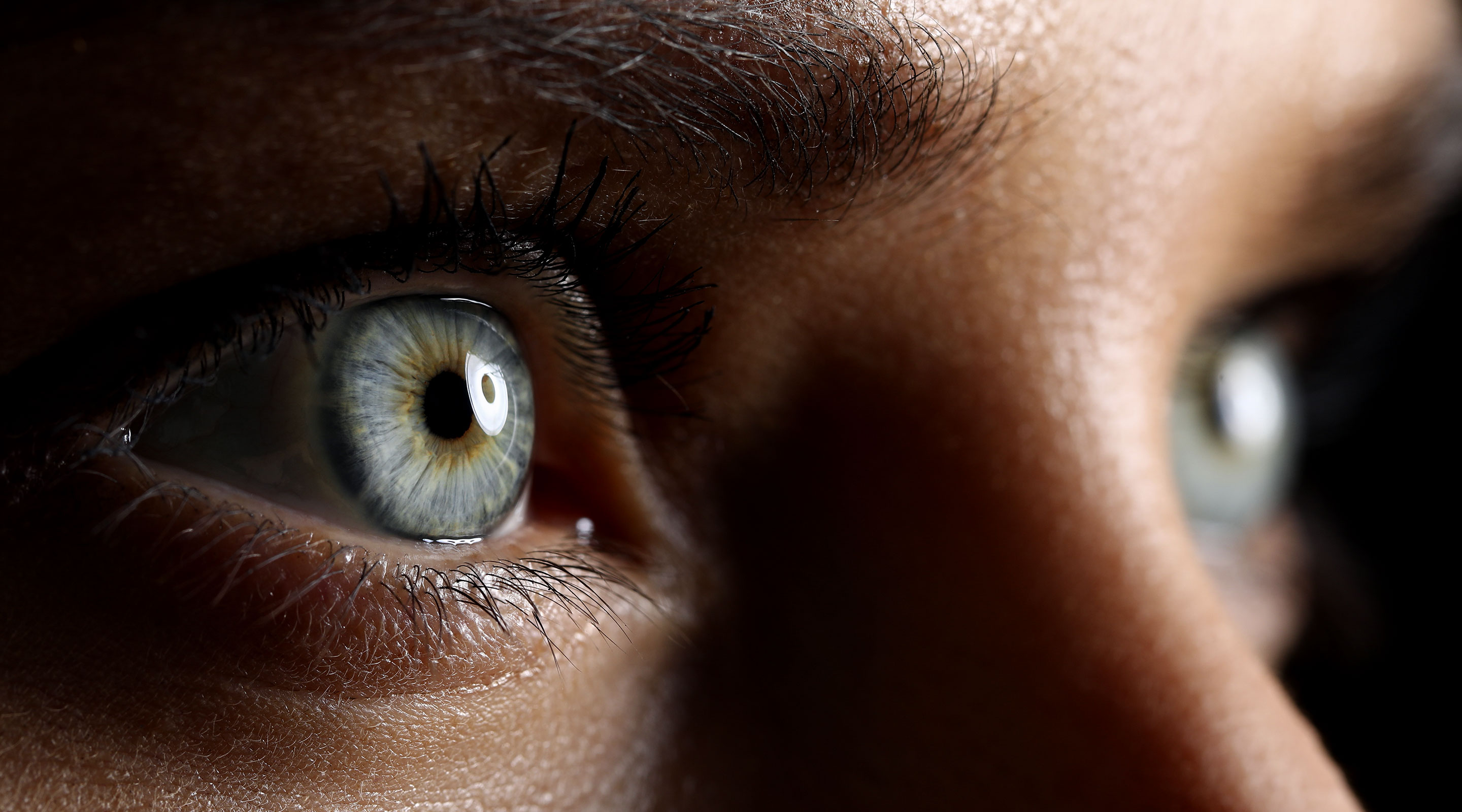 Close up of eyes focussing on the distance