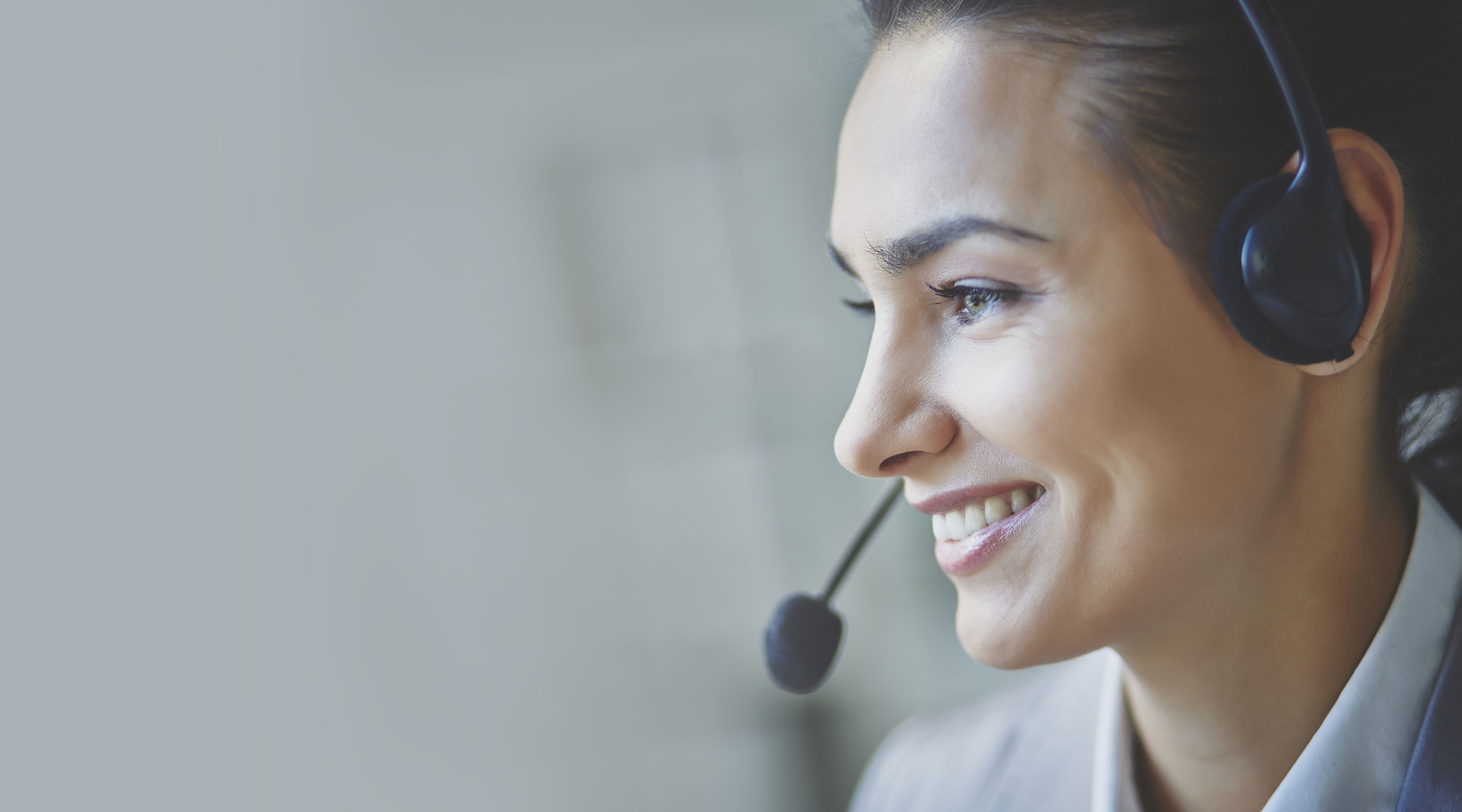 Smiling professional woman taking over a headset