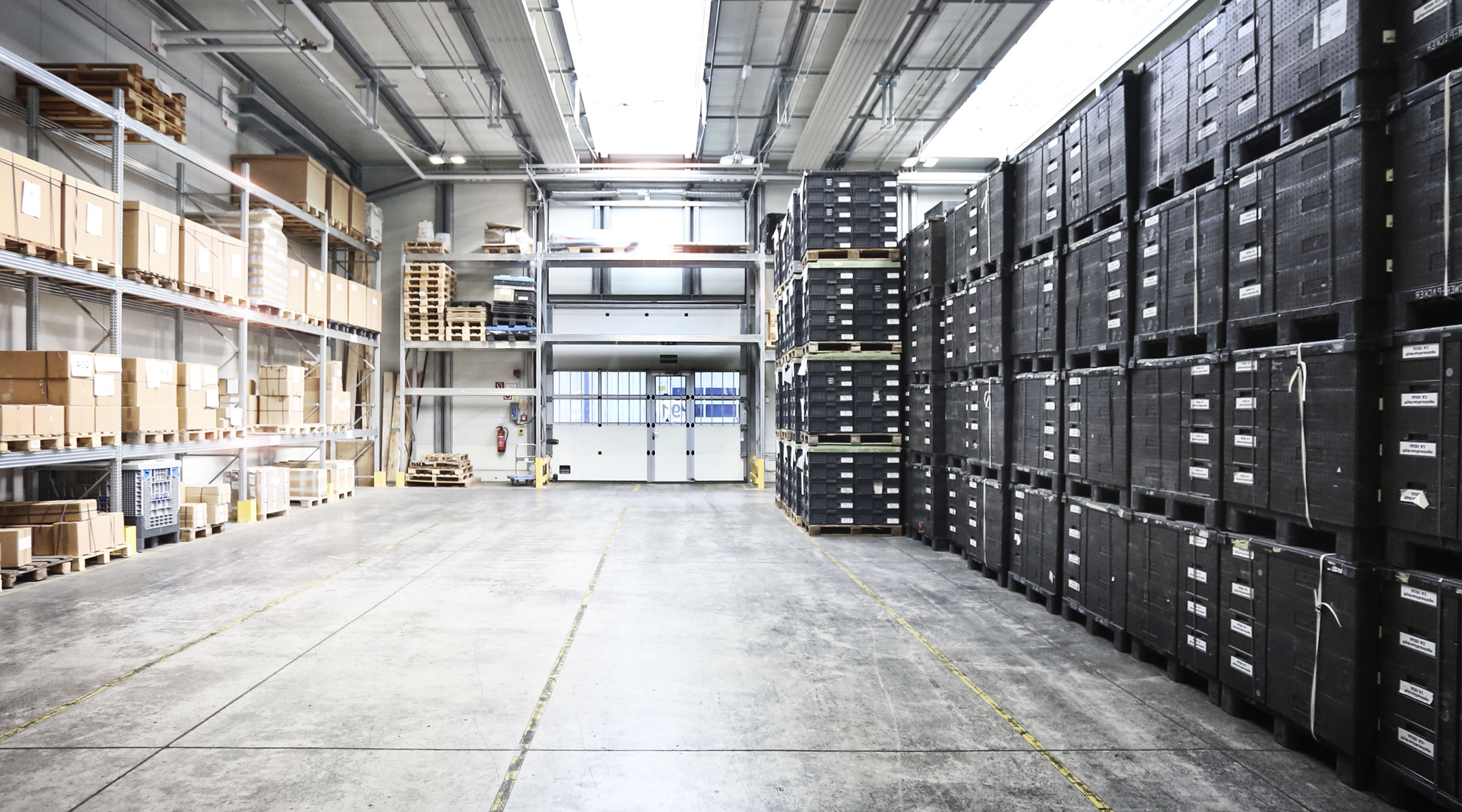 Warehouse interior with crates stacked neatly