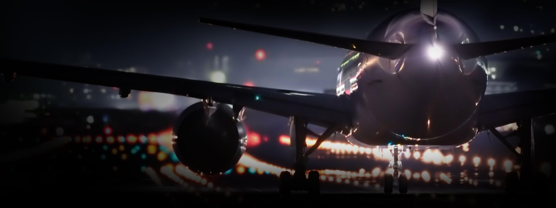 Aircraft on runway at night