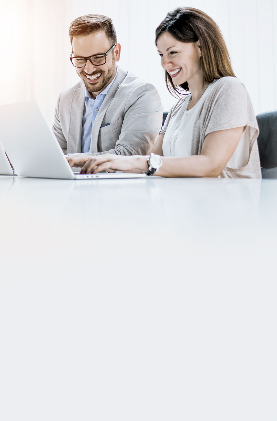 Two people enjoying working together
