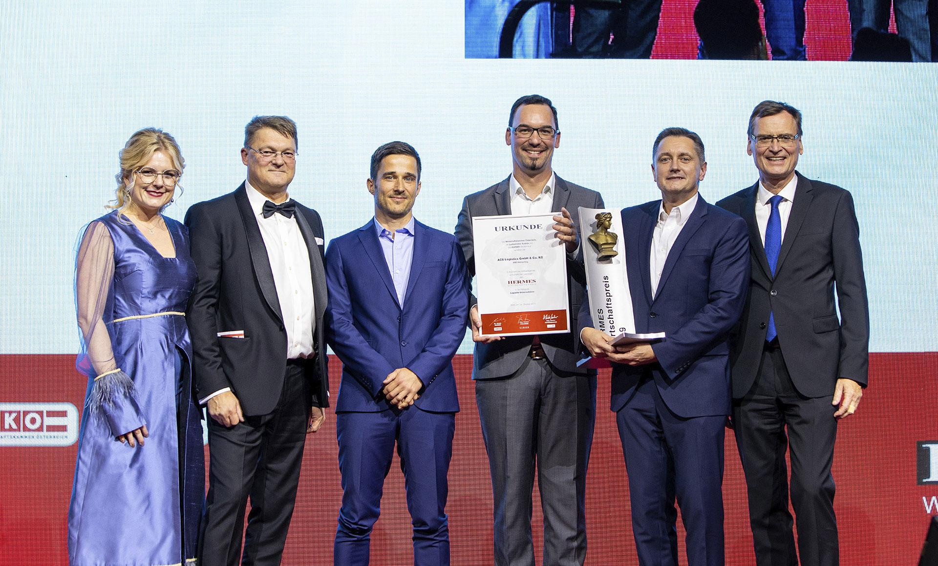 ACSL Management receiving the award