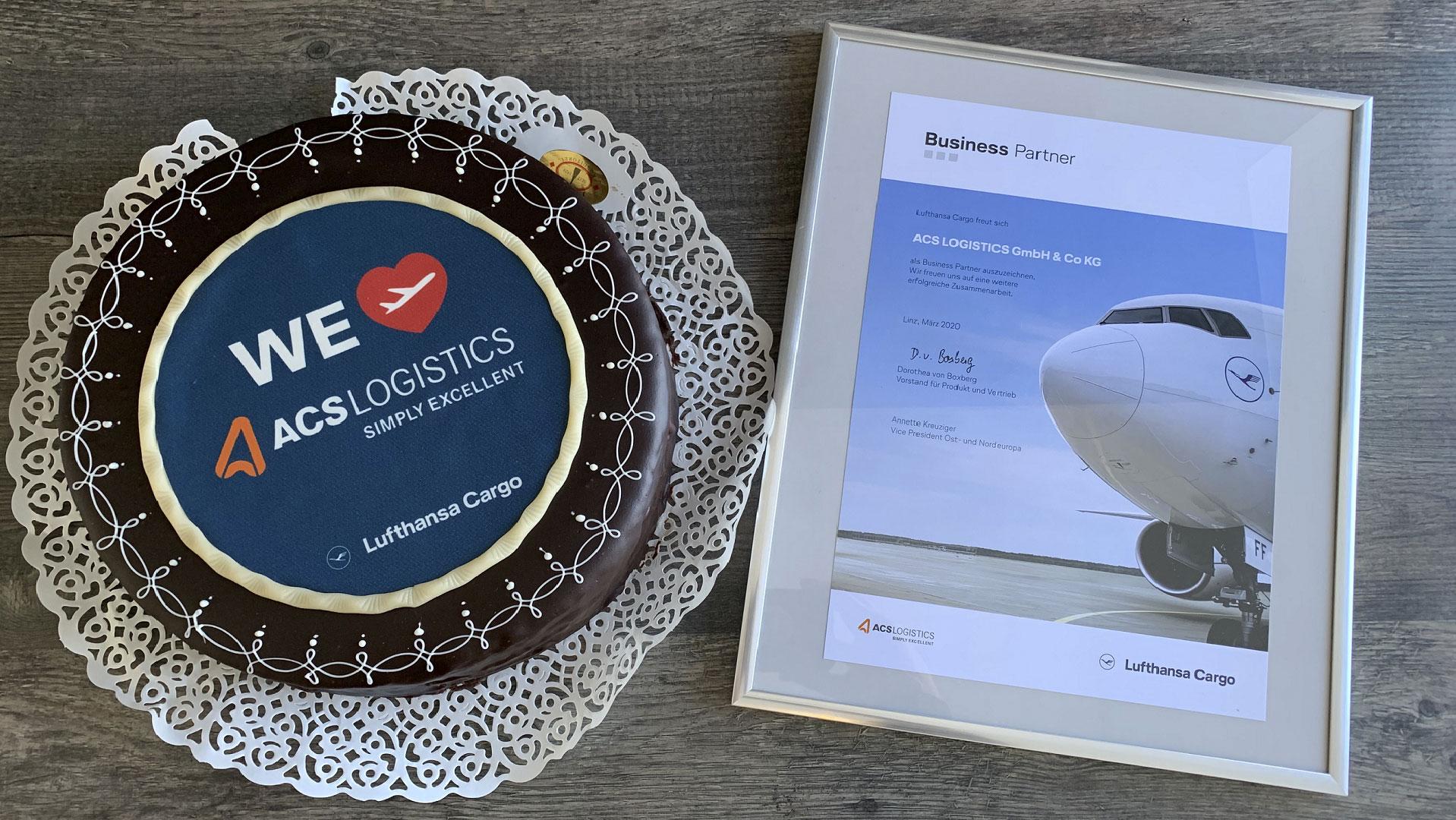 Cake with Lufthansa Cargo logo and ACS Logistics logo